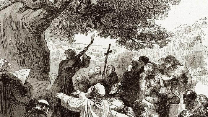 Bonifatius fllt mit einer Axt eine dicke Eiche Christen schauen dabei zu